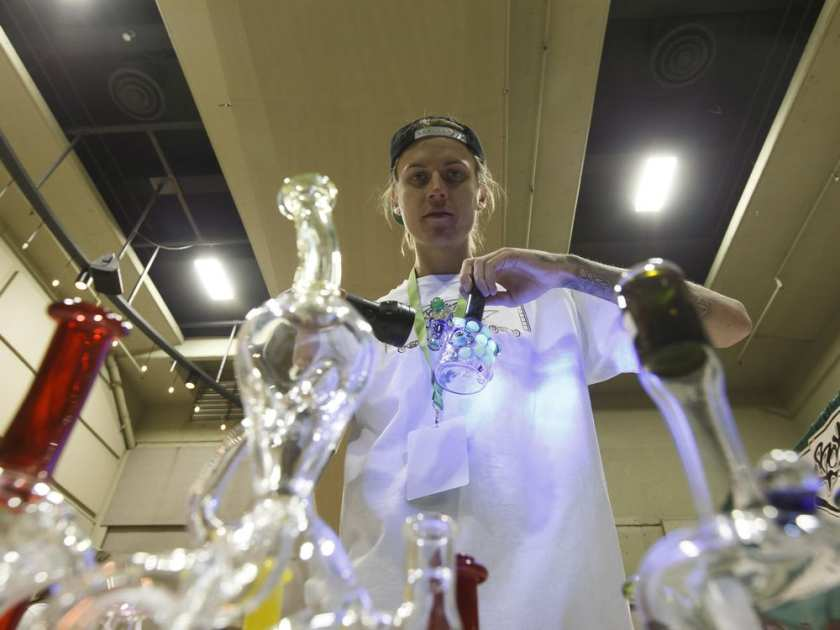 John Carlson with Boxcar Studios demonstrates how some glass works glow under ultraviolet light at HempFest Cannabis Expo at Shaw Conference Centre in Edmonton on Saturday, March 11, 2017.