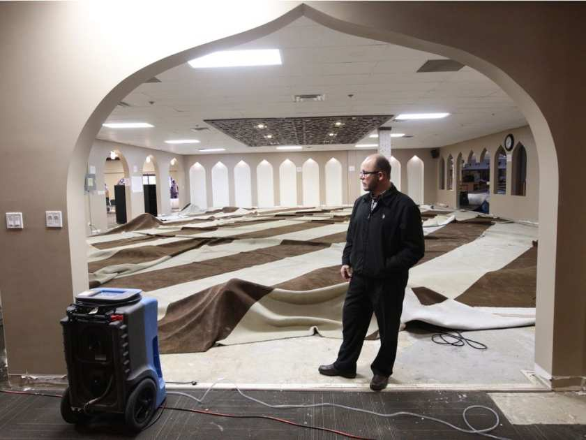 Centre Manager Bassam Fares looks at the damage following a flood at the MAC Islamic Centre, 6104 172 St., in Edmonton, AB on Tuesday April 18, 2017. Photo by David Bloom