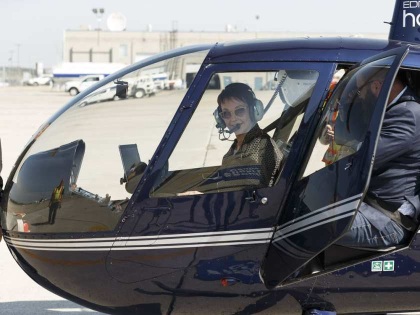 Jaala Pulford (left), Minister of Agriculture and of Regional Development for the State of Victoria in Australia, and Shaye Anderson (right), MLA for Leduc-Beaumont and Minister of Municipal Affairs, fly on a helicopter to tour the Aurora Sky cannabis project at Edmonton International Airport in Nisku on Thursday, July 13, 2017.